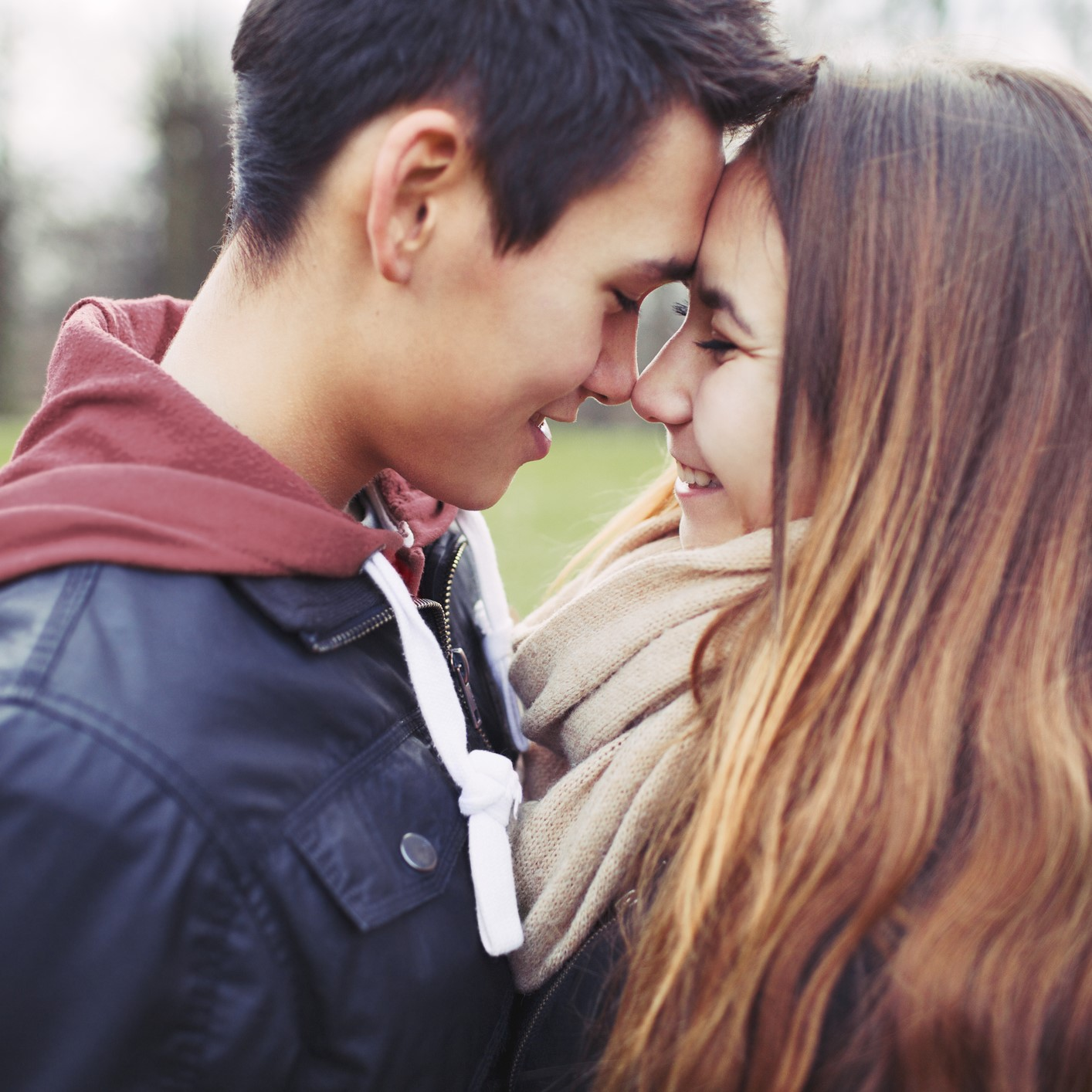 Close up of teenage couple with foreheads touching