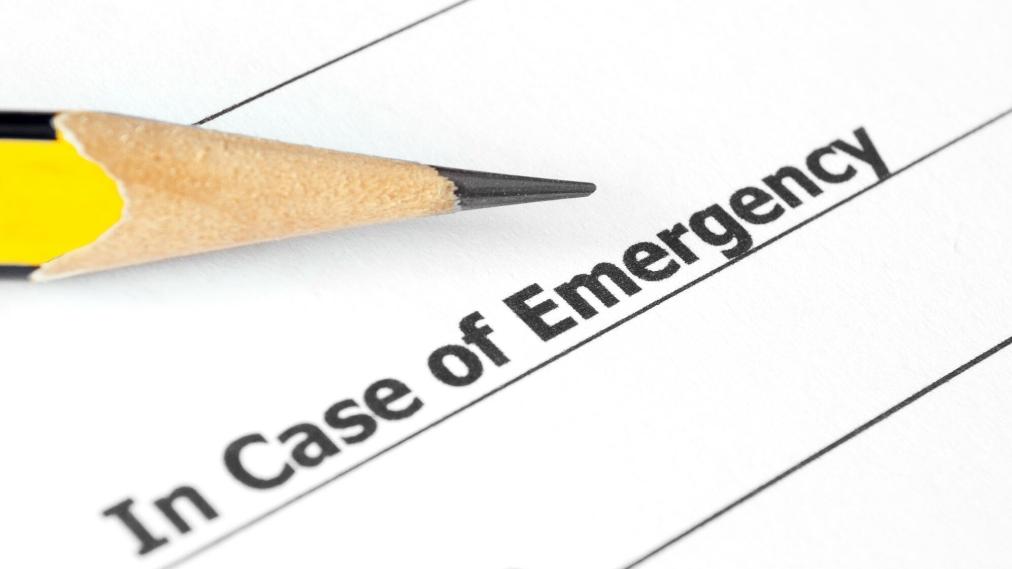 Close-up of Emergency document with pencil