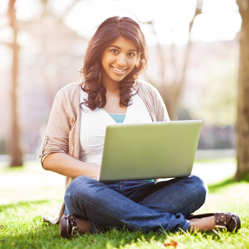 A student using laptop on campus