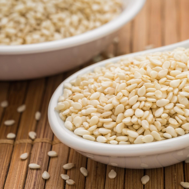 Sesame seeds on spoon